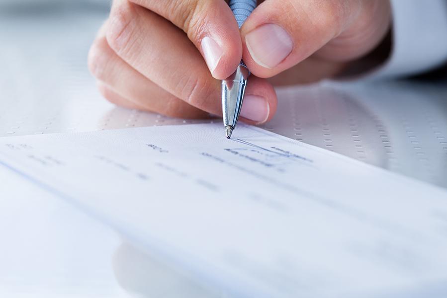 CFO signing paycheck